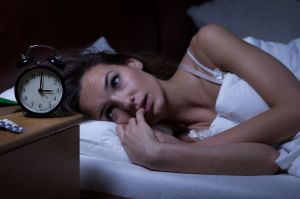 woman-bed-scared-canstockphoto22617451